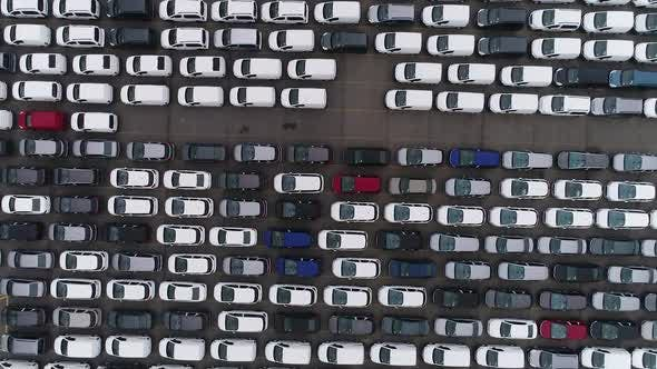 Cover Image for Top View of Storage Parking Lot New Unsold Cars