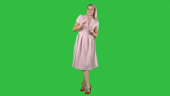 Thumbnail for Cute girl full length in pink dress talking to camera and