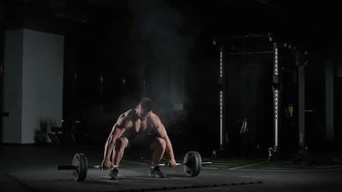 Weightlifting Caucasian Athletic Man Performs Exercises with Barbell Lifts Barbell and Does Weights