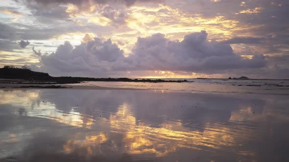 Thumbnail for Background plate of beautiful and reflective sandy beach at sunset in Costa Rica