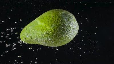 Avocado falls into water