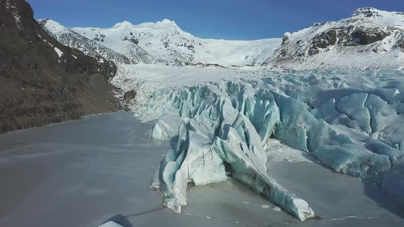 Thumbnail for Aerial View of the Sv Nafellsj Kull Glacier in Sunny Weather, The Beginning of Spring in Iceland