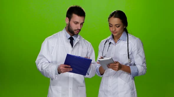 Thumbnail for Paramedics Discuss Diagnosis of the Patient. Green Screen