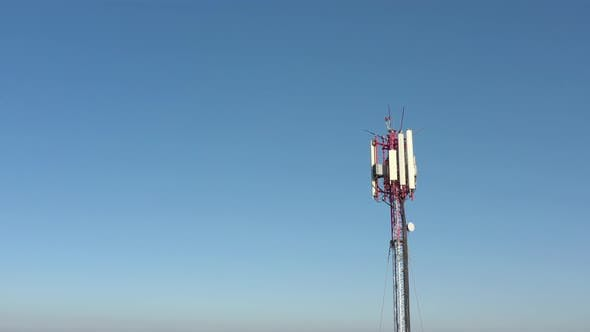 Thumbnail for Panels of telecommunication tower against blue sky 4K aerial video