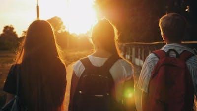 Classmates Walking Down the Street at Sunrise