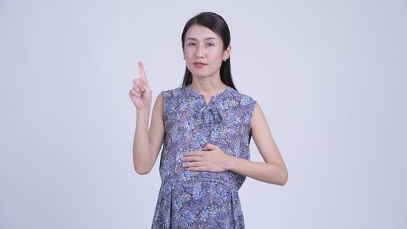 Thumbnail for Happy Pregnant Asian Woman Explaining Something