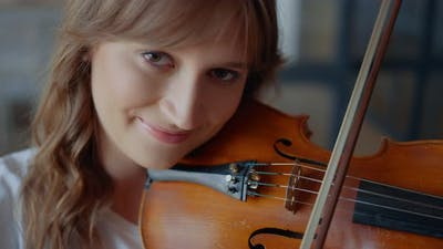Girl Playing Violin with Bow. Musician Performing Musical Composition on Violin