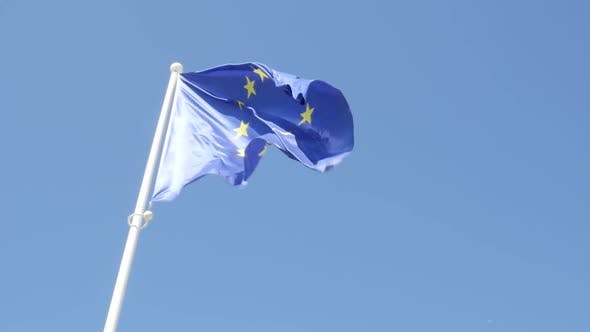 Thumbnail for EU flag in front of blue sky slow waving on wind slow motion 1080p HD footage -  European Union flag