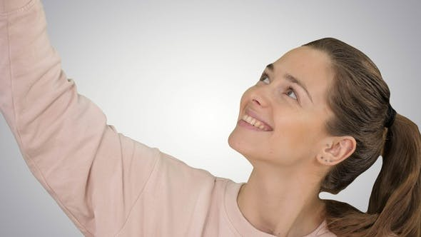 Thumbnail for Smiling cheerful blond-haired woman doing selfie on gradient