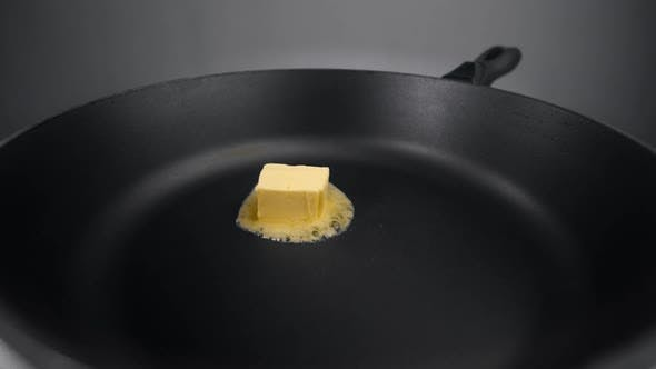 Thumbnail for Chef Greases the Hot Pan with Butter, Melting Butter on the Pan, Butter on the End of the Knife