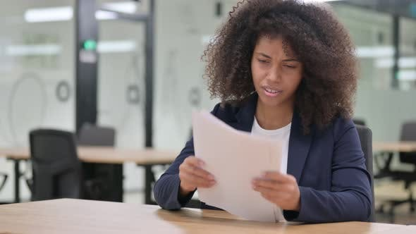 Thumbnail for Displeased African Businesswoman with Loss Reading Documents