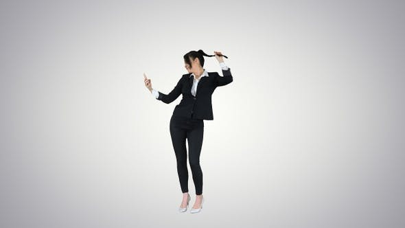 Thumbnail for Business woman look into smart phone preening and dancing