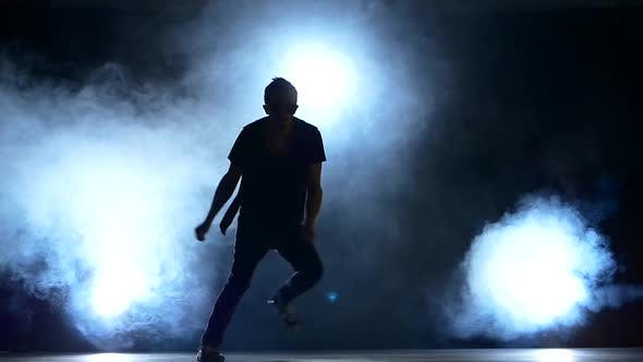 Thumbnail for Young Hiphop Dancer Making a Move, Jump, Smoke, Silhouette, Slow Motion