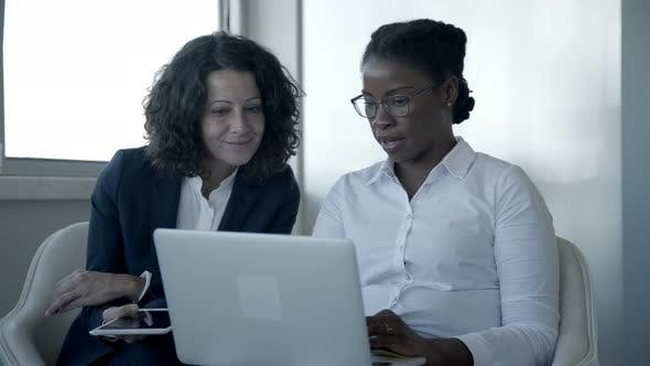 Thumbnail for Smiling Businesswomen with Laptop and Tablet Pc