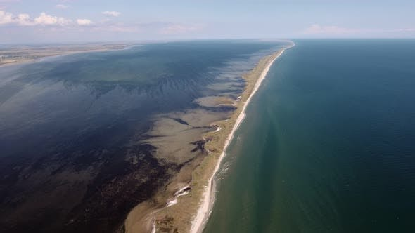 Thumbnail for Aerial Shot of a Straight Sand Line at the Black Sea Shelf on a Sunny Day in Summer