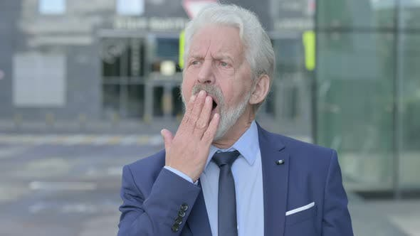 Yawning Old Businessman Outdoor