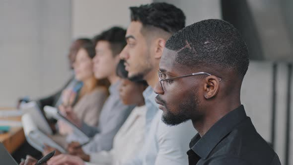 Multinational Group of Workers Managers Multiracial Diversity Business Team Listening to Lecture