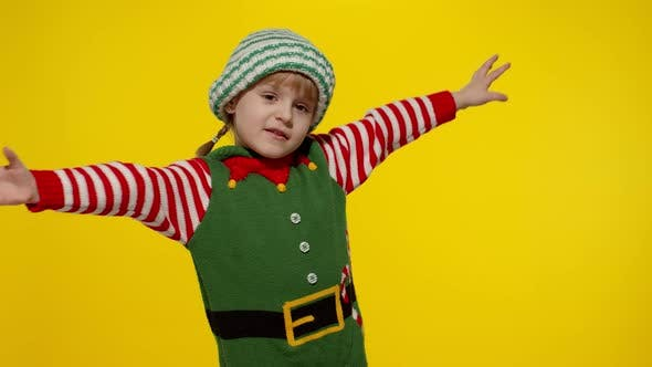 Kid Girl in Christmas Elf Santa Helper Costume Dancing Fooling Around