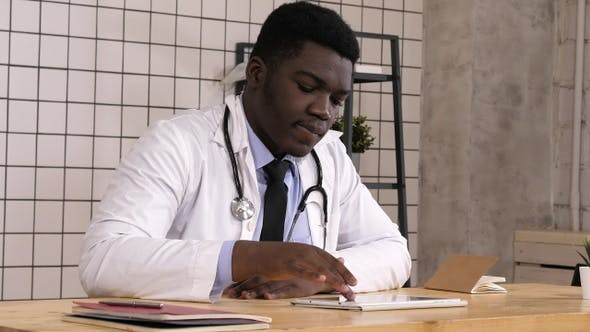 Thumbnail for Happy young african american health care worker with tablet