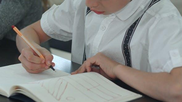 Thumbnail for Boy Hands Doing Homework