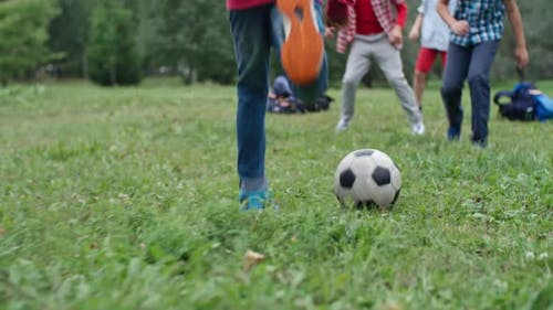 Children Playing with Football
