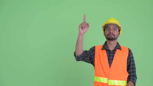 Cover Image for Young Bearded Persian Man Construction Worker Thinking While Pointing Up