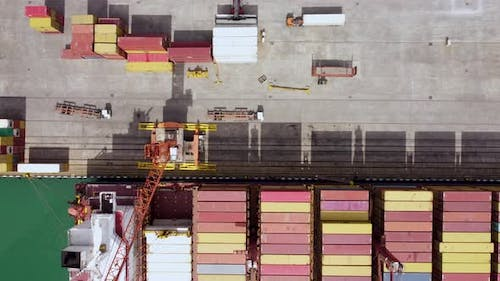 Unloading Cargo Ship In The Port