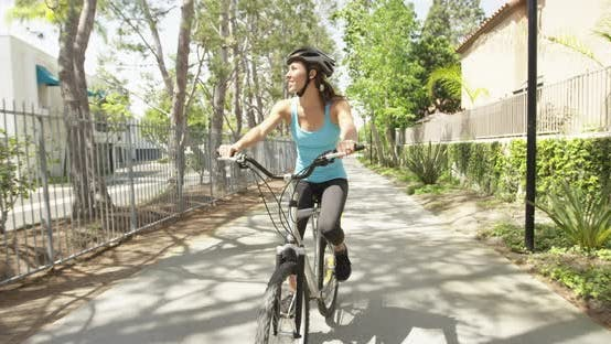 Thumbnail for Fit woman riding bike on path