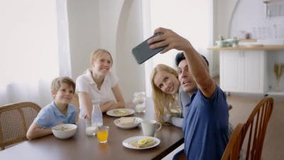Father Taking Selfie While Eating Breakfast