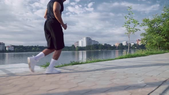 Thumbnail for Muscular Young Afro American Guy Running Near Lake