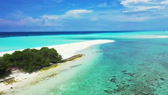 Luxury drone abstract shot of a summer white paradise sand beach and blue ocean background in vibran
