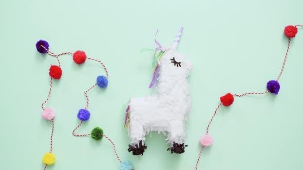 Thumbnail for Small unicorn pinata for kids birthday party.