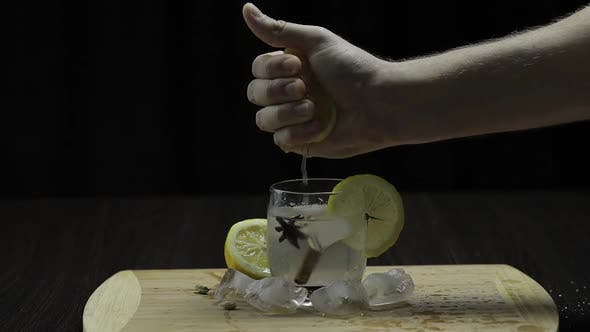 Thumbnail for Squeezing Lemon Juice Into a Glass. Fornt View