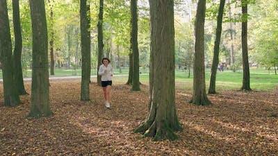 Woman Taking Break Between Workout Outdoors