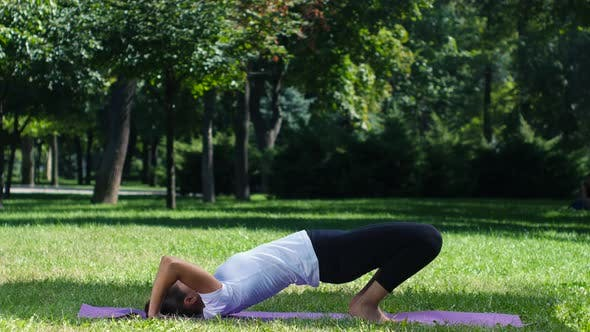 Thumbnail for Woman Practicing Yoga in the Park