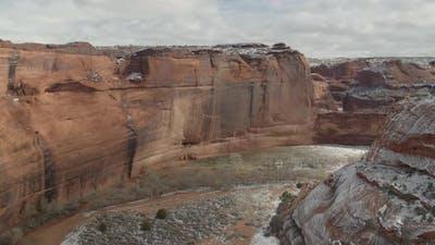 A flight through a snow covered canyon