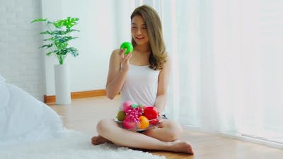Healthy Asian woman holding fresh healthy fruits and happiness,Health care Concept
