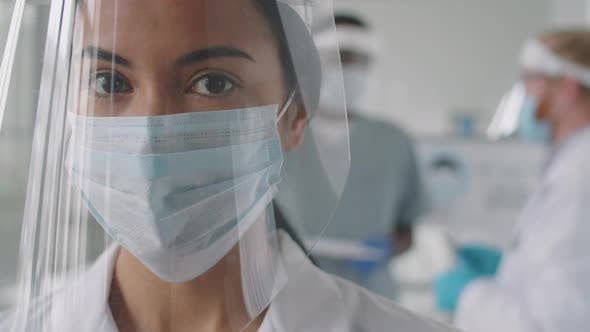 Thumbnail for Portrait of Female Doctor in Protective Screen and Mask