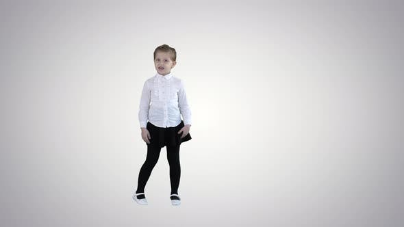 Thumbnail for Cute Little Girl Smiling and Confidently Talking To Camera on Gradient Background.