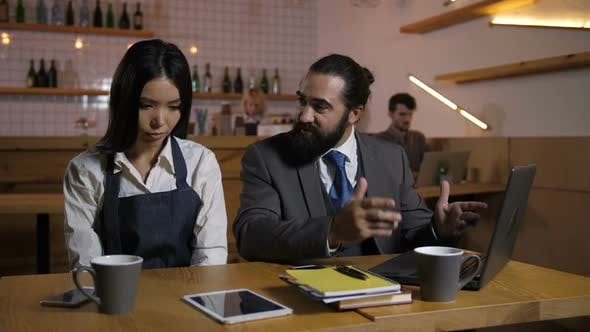 Cover Image for Strict Manager Reprimanding Employee at Cafe