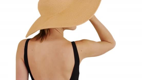 Thumbnail for Rear view of woman in floppy sunhat on solid white background