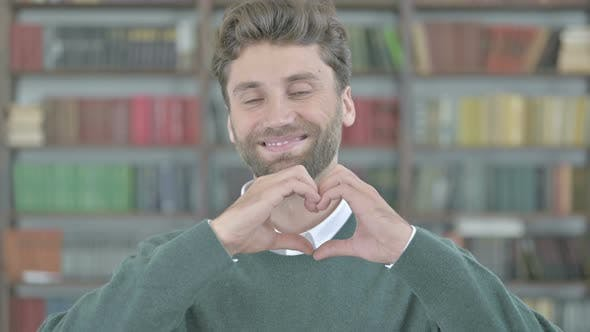 Thumbnail for Cheerful Young Man Making Heart Shape with Hand