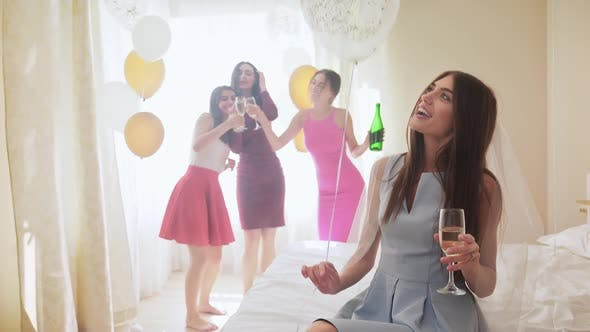 Thumbnail for Happy Attractive Women Drinking Champagne at Hen Party