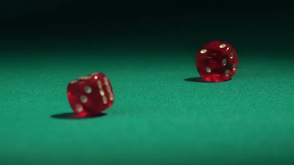 Thumbnail for Closeup of dice falling on green casino table, betting on huge amount of money