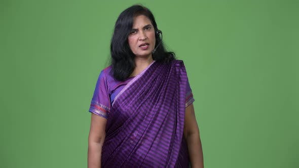 Thumbnail for Mature Beautiful Indian Woman As Call Center Representative Talking on Headset