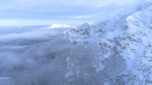 Thumbnail for Away from Snowy Mountains and over a Foggy Valley