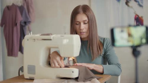 Woman Sewing With Sewing Machine