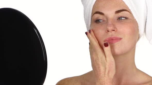 Thumbnail for Young Woman Applying Face Cream, Close Up, Slow Motion