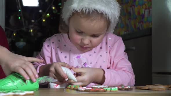Thumbnail for Girl Paints Christmas Cookies.