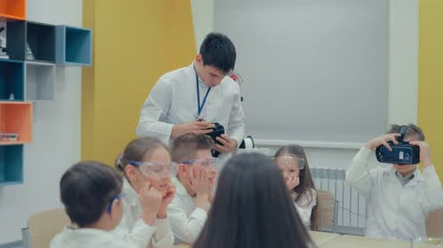 Schoolboy Using Virtual Reality Glasses in Classroom at School